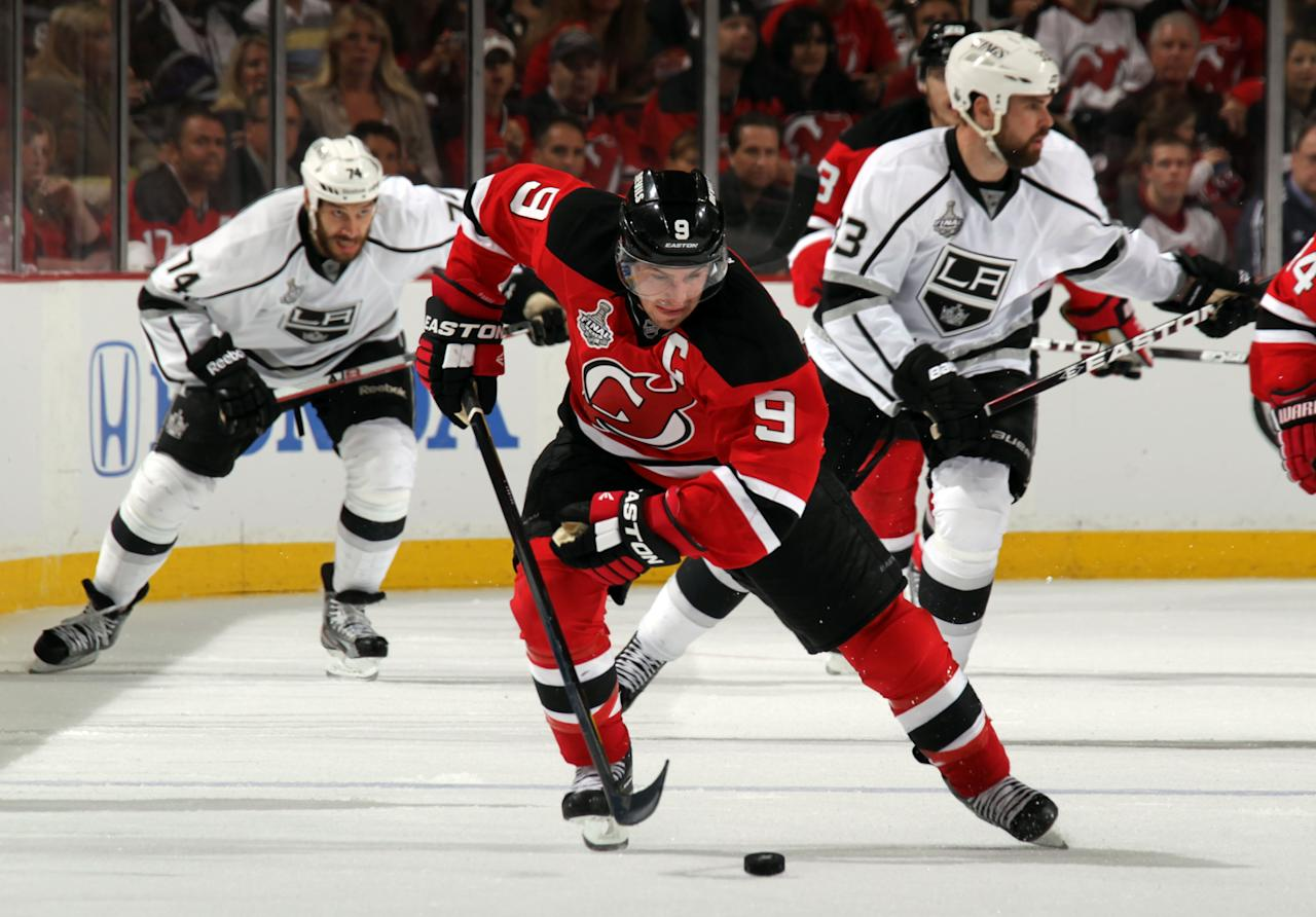 NEWARK, NJ - MAY 30: Zach Parise #9 of the New Jersey Devils handles the puck against the Los Angeles Kings during Game One of the 2012 NHL Stanley Cup Final at the Prudential Center on May 30, 2012 in Newark, New Jersey.  (Photo by Bruce Bennett/Getty Images)
