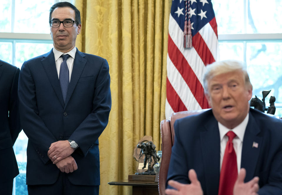 Treasury Secretary Steven Mnuchin looks on as President Donald Trump spoke by phone with foreign leaders at the White House in Washington, Oct. 23, 2020. (Stefani Reynolds/The New York Times)