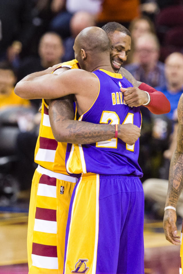 CLEVELAND, OH - FEBRUARY 10: LeBron James #23 of the Cleveland Cavaliers greets Kobe Bryant #24 of the Los Angeles Lakers prior to the game at Quicken Loans Arena on February 10, 2016 in Cleveland, Ohio. NOTE TO USER: User expressly acknowledges and agrees that, by downloading and/or using this photograph, user is consenting to the terms and conditions of the Getty Images License Agreement. Mandatory copyright notice. (Photo by Jason Miller/Getty Images)
