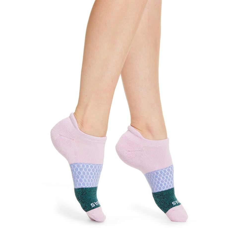 """Everyone needs socks, so if you're looking to a gift a feel-good stocking stuffer, get them a pair of colorful Bombas. For every pair purchased, the brand will donate another one to charity. $12, Nordstrom. <a href=""""https://shop.nordstrom.com/s/bombas-tri-block-marl-ankle-socks/5214462?"""">Get it now!</a>"""