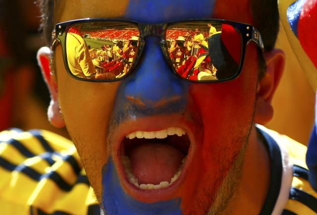 A Colombia fan poses before the 2014 World Cup Group C soccer match between Colombia and Ivory Coast at the Brasilia national stadium in Brasilia June 19, 2014. REUTERS/Eddie Keogh (BRAZIL - Tags: SOCCER SPORT WORLD CUP)