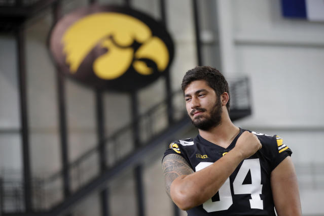 FILE - In this Aug. 10, 2018, file photo, Iowa defensive end A.J. Epenesa poses for photographers during an NCAA college football media day, in Iowa City, Iowa. Iowa junior Epenesa knows that he has a strong shot at being picked in the first round of the 2020 NFL Draft should he choose to go pro next spring. Hes just choosing not to think about it until then. Epenesa, a 6-foot-6, 280-pound defensive end who led the Big Ten with 10.5 sacks a year ago despite coming off the bench, is poised for a monster season in 2019. (AP Photo/Charlie Neibergall, File)