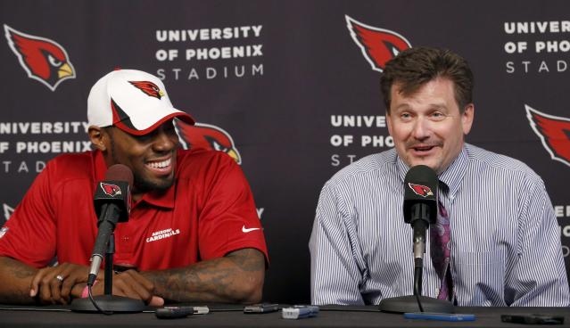 The Arizona Cardinals football team president Michael Bidwill, right, answers a question after introducing Antonio Cromartie, the NFL football team's latest signing, Thursday, March 20, 2014, in Tempe, Ariz. Cromartie last played for the New York Jets. (AP Photo/Ross D. Franklin)