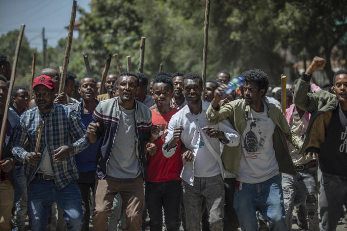 A group of supporters perform and shout slogans at the house of opposition leader Jawar Mohammed to show their support, in Addis Ababa, Ethiopia, Thursday Oct. 24, 2019. Ethiopia's Nobel Peace Prize-winning prime minister Abiy Ahmed faced the most serious political challenge of his short rule Thursday as officials said dozens of people might be dead in two days of unrest, and Jawar Mohammed hinted that he might enter next year's election race to challenge Abiy to become Prime Minister. (AP photo Mulugeta Ayene)