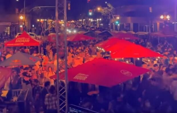Hudsons hosted this packed outdoor downtown block party in Saskatoon on Aug. 27 and again the following night.  (Hudsons/Facebook - image credit)