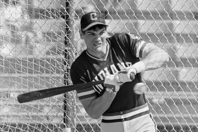 "FILE - In this March 5, 1982, file photo, Cleveland Indians left fielder Joe Charboneau gets jammed in the batting cage at Cleveland's spring training camp in Tucson, Ariz. The charismatic Charboneau arrived on the scene as that promising prospect who was the life of the party. His tales were epic off the field — opened beer bottles with his forearm or his eye socket (just once or twice, he cautioned). Once fixed a broken nose with pliers. Stitched up a cut with fishing line. Charboneau sees a little bit of himself in the iconic baseball film ""The Natural,"" that finished tied for No. 8 in The Associated Press Top 25 favorite sports movies poll. (AP Photo/Sal Veder, Fle)"