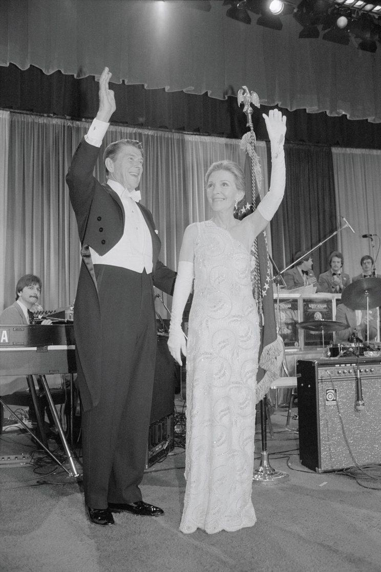 Ronald and Nancy Reagan wave to guests.