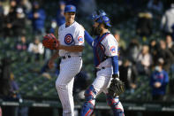 Chicago Cubs closing pitcher Jason Adam left, celebrates with catcher Austin Romine right, after defeating the Atlanta Braves in a Major League baseball game Saturday, April 17, 2021, in Chicago. (AP Photo/Paul Beaty)