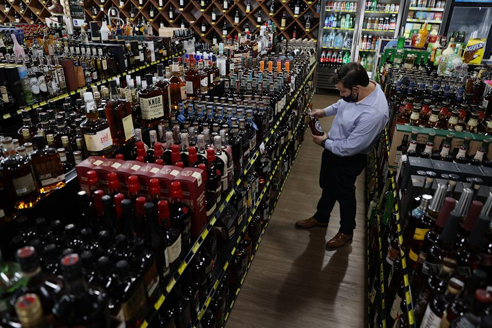 MIAMI, FLORIDA - FEBRUARY 03: Ramon Baez shops for bourbon at Jensen's Liquors on February 03, 2021 in Miami, Florida. The Distilled Spirits Council reported that U.S. distillers' revenue grew 7.7% to $31.2 billion last year, marking the fastest growth and highest sales for at least 40 years. Alcohol that sold for above $40 per 750 milliliters accounted for 40% of the U.S. spirits industry's growth in 2020, compared with 34% in 2019. (Photo by Joe Raedle/Getty Images)