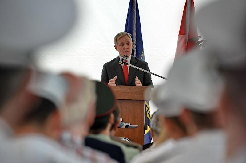 US Secretary of the Navy Ray Mabus (C) delivers remarks aboard the USS Freedom during his visit to the naval ship at Changi Naval Base in Singapore on May 11, 2013