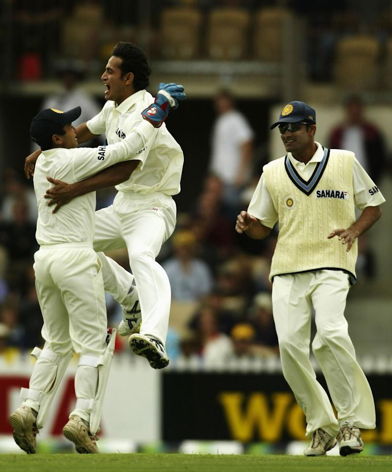 ADELAIDE, AUSTRALIA - DECEMBER 12:  Keeper Parthiv Patel celebrates with Irfan Pathan of India after the wicket of Matthew Hayden during the 2nd Test between Australia and India at the Adelaide Oval on December 12, 2003 in Adelaide, Australia.  (Photo by Mark Dadswell/Getty Images)