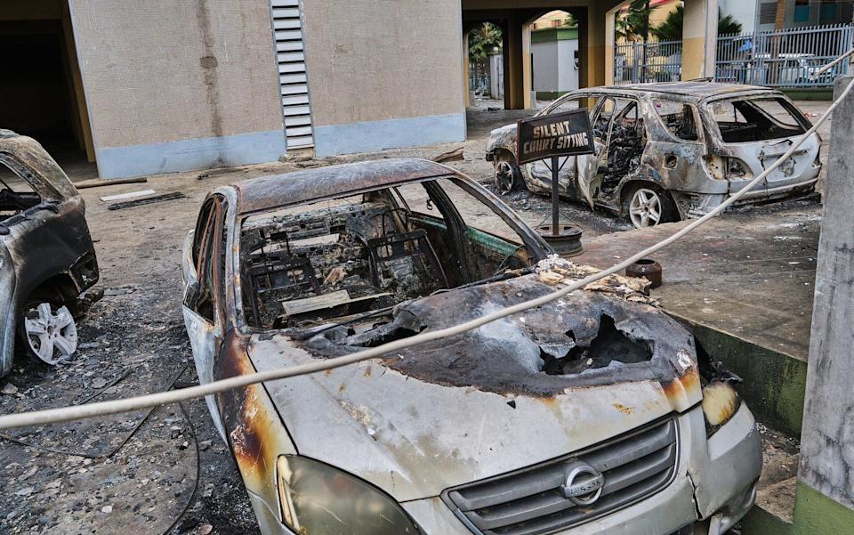 Following two weeks of protests against The Nigerian Police Special Anti-Robbery Squad, otherwise known as SARS, burnt vehicles and damaged buildings remain visible across Lagos -  Anadolu Agency / Anadolu