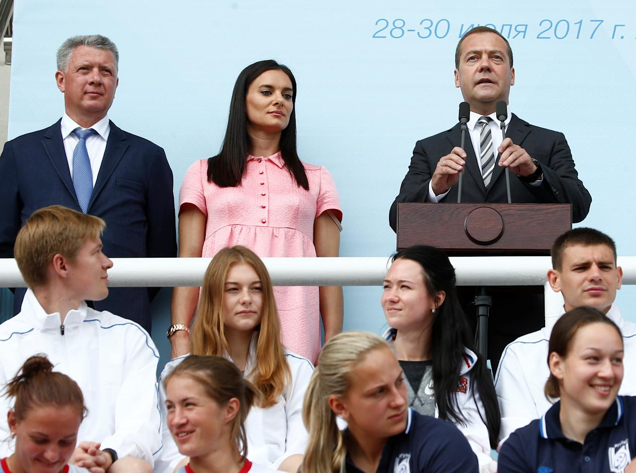 Athletics - Russian Athletics Cup - Meteor Stadium, Zhukovsky, Russia - July 28, 2017 - Russian Prime Minister Dmitry Medvedev, two time Olympic pole vault champion Yelena Isinbayeva and President of the Russia's athletics federation Dmitri Shlyakhtin attend an opening ceremony. REUTERS/Sergei Karpukhin