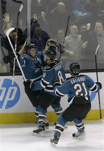 San Jose Sharks center Joe Pavelski (8) celebrates after scoring a goal with defenseman Matt Irwin (52) and left wing T.J. Galiardi (21) during the third period of an NHL hockey game against the Calgary Flames in San Jose, Calif., Friday, April 5, 2013. The Sharks won 2-1. (AP Photo/Jeff Chiu)