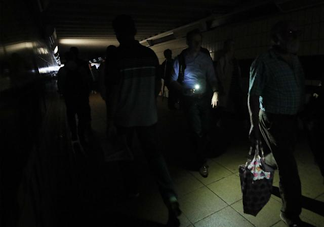 Commuters are plunged into darkness during rush hour as a widespread power cut hit London, the south east and other parts of the country (GETTY)