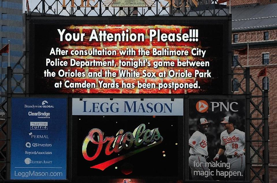 An announcement on the scoreboard notifies fans that the game between the Baltimore Orioles and the Chicago White Sox has been postponed, on April 27, 2015 in Baltimore (AFP Photo/Greg Fiume)