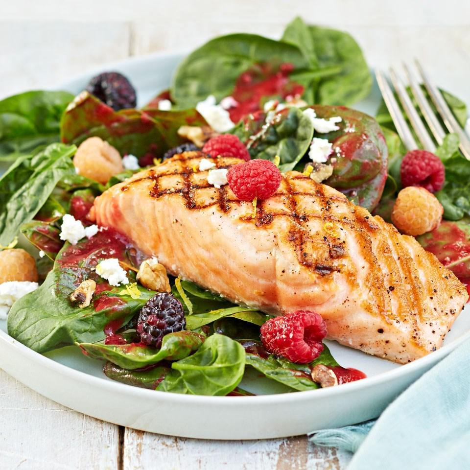 <p>Homemade raspberry dressing? You bet. Prep it a day ahead and this easy salmon salad will come together in no time.</p>