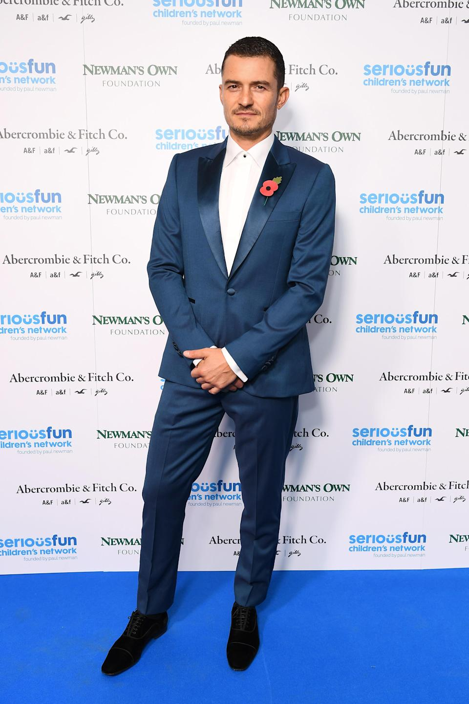 <p>The 41-year-old British star suited up for a good cause at the SeriousFun London Gala, pairing his poppy with a slick, blue suit. <span><em>[Photo: Getty]</em></span> </p>