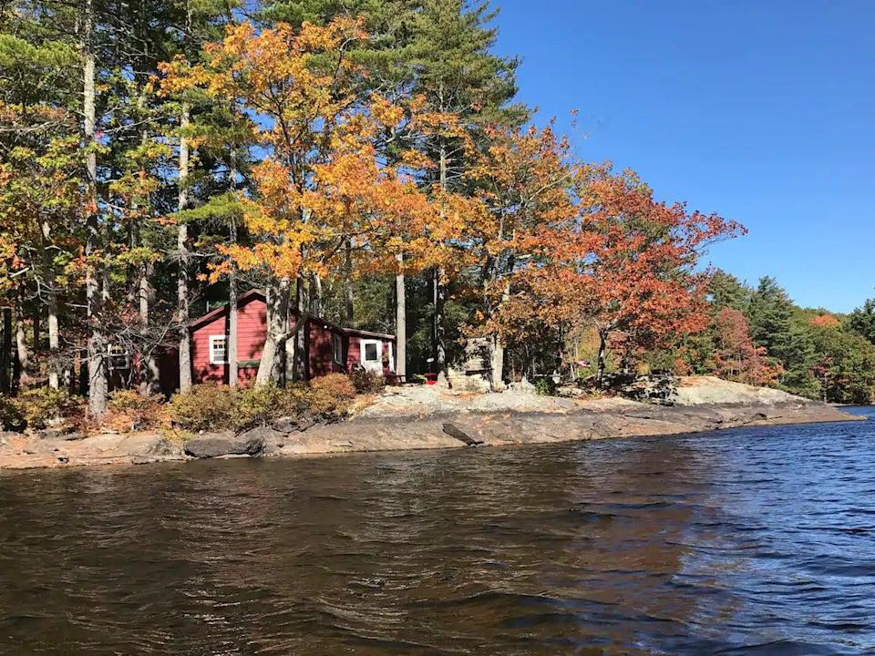 """<h2>Intimate Lakeside Maine Cottage</h2><br><strong>Location: </strong>Lincolnville, Maine<br><strong>Sleeps: 6</strong><br><strong>Price Per Night: </strong>$375<br><em>Check availability <strong><a href=""""http://airbnb.pvxt.net/JrrgeN"""" rel=""""nofollow noopener"""" target=""""_blank"""" data-ylk=""""slk:here"""" class=""""link rapid-noclick-resp"""">here</a></strong></em><br><br>""""Spend a week, spend 2 weeks, spend the month in a little piece of heaven on earth at The McLellan Cottage on Norton's Pond, connected to Megunticook Lake in Lincolnville Maine, 10 minutes from the idyllic and charmed Camden, Maine.""""<br>"""