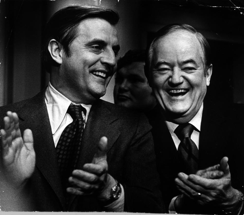 Sens. Walter Mondale (at left) and Hubert Humphrey applaud a fellow DFLer, Minnesota Gov. Wendell Anderson, during Anderson's inaugural message on January 8, 1975, (Kent Kobersteen/Minneapolis Tribune via AP)