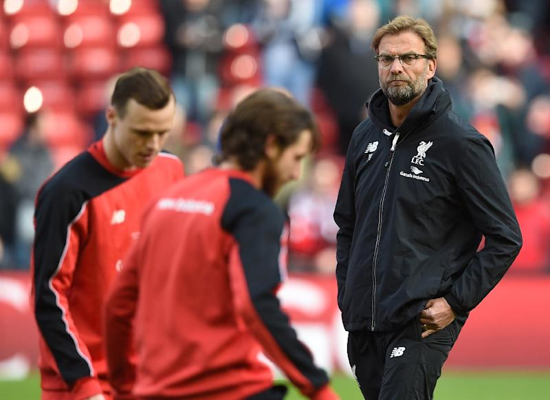 Jurgen Klopp (right) spent seven years at Dortmund, but is now plotting the downfall of his former employers as Liverpool bid to add to their haul of 11 European trophies (AFP Photo/Paul Ellis)