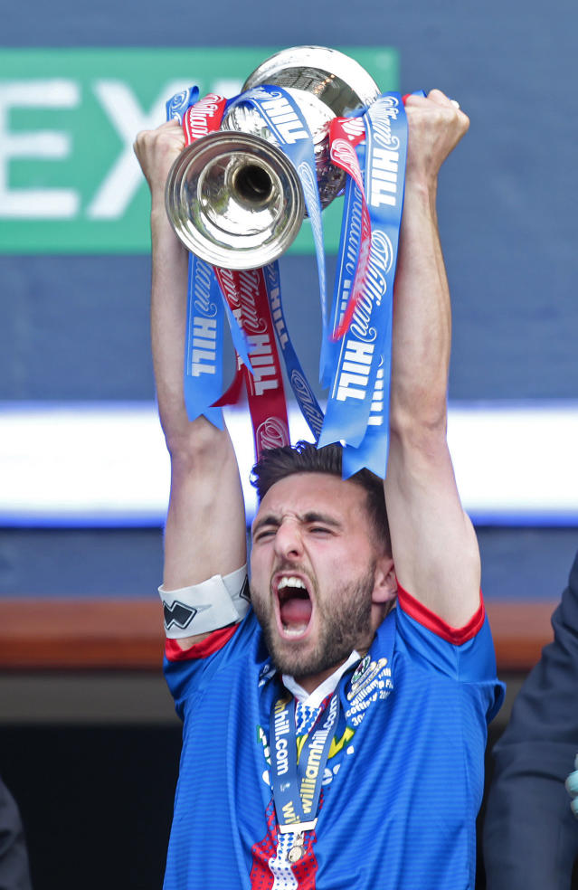 "Football - Falkirk v Inverness Caledonian Thistle - William Hill Scottish FA Cup Final - Hampden Park, Glasgow, Scotland - 30/5/15 Inverness Caledonian Thistle's Graeme Shinnie lifts the trophy after winning the William Hill Scottish FA Cup Final Action Images via Reuters / Graham Stuart Livepic EDITORIAL USE ONLY. No use with unauthorized audio, video, data, fixture lists, club/league logos or ""live"" services. Online in-match use limited to 45 images, no video emulation. No use in betting, games or single club/league/player publications. Please contact your account representative for further details."