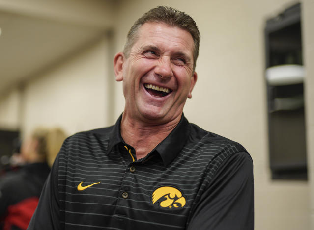 Iowa NCAA college baseball head coach Rick Heller laughs in Omaha, Neb., Tuesday, May 22, 2018, during a media availability ahead of the Big Ten tournament. Minnesota is the top seed, Purdue is red hot, and defending champion Iowa is looking to get to the title game for the third straight year. The Big Ten Tournament looks to be wide open as it returns to TD Ameritrade Park for the third time since 2014. (AP Photo/Nati Harnik)