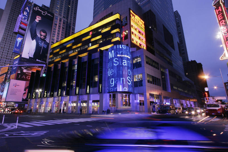 In this Tuesday, Dec. 19, 2006, photo, early morning traffic passes the Morgan Stanley building in New York's Times Square .Morgan Stanley Inc., the world's second-largest investment house, reports earnings Thursday, July 19, 2013. (AP Photo/Mark Lennihan)