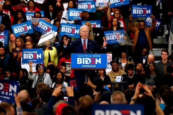 Democratic presidential candidate former Vice President Joe Biden gestures as he speaks during a campaign rally at Renaissance High School in Detroit, Michigan.