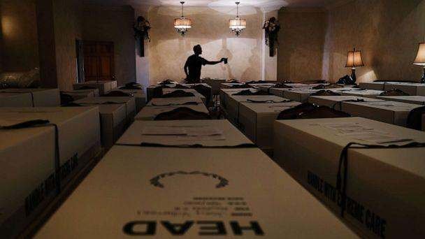 PHOTO: Omar Rodriguez organizes bodies in the Gerard Neufeld funeral home in the Queens borough of New York, April 22, 2020. (Spencer Platt/Getty Images)