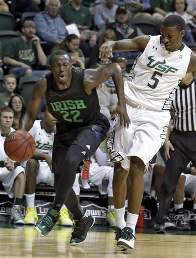 Notre Dame guard Jerian Grant (22) is fouled by South Florida guard Jawanza Poland (5) as he goes to the basket during the first half of an NCAA college basketball game Saturday, Jan. 26, 2013, in Tampa, Fla. (AP Photo/Chris O'Meara)