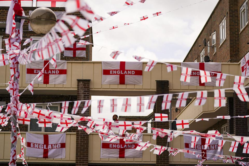 The residents of Towfield Court in Feltham have transformed their estate with England flags (Steve Parsons/PA) (PA Wire)