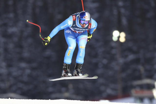 Italy's Dominik Paris speeds down the course during the downhill portion of the men's combined, at the alpine ski World Championships in Are, Sweden, Monday, Feb.11, 2019. (AP Photo/Marco Trovati)