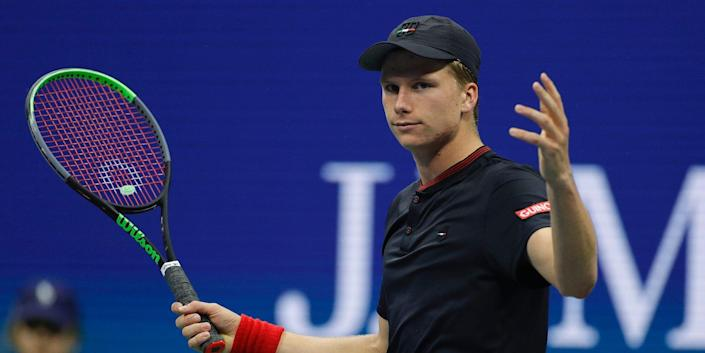 Jenson Brooksby holds up his hands during a match at the US Open