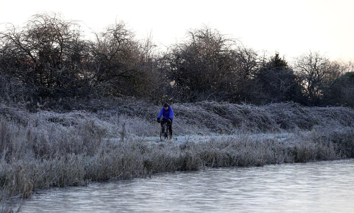 A cyclist enjoys the frost in Scotland this morning (PA)