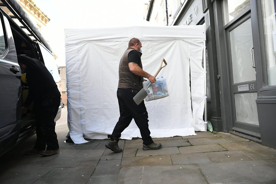 <p>Police have begun excavating the cellar of the Clean Plate cafe</p> (PA Wire)