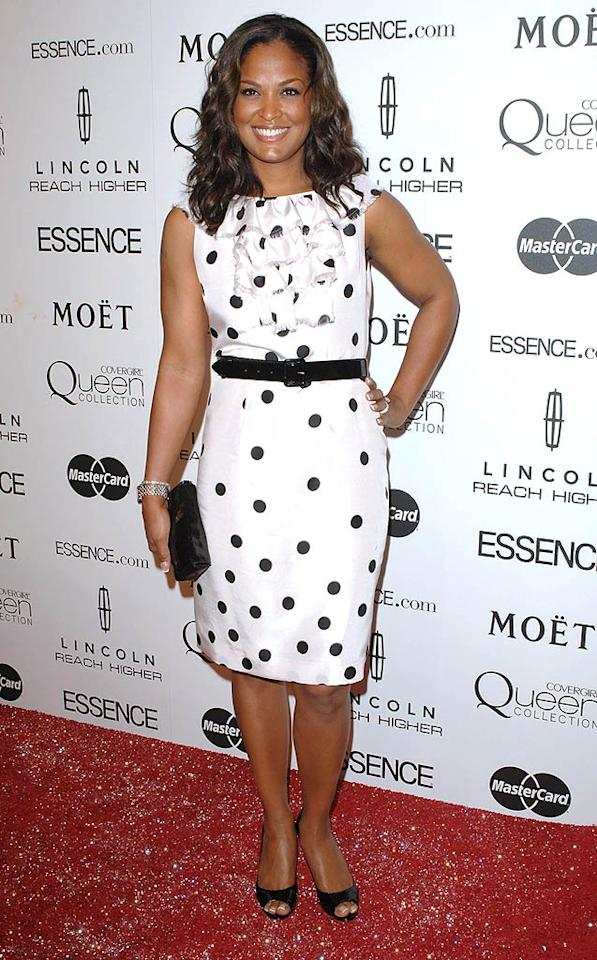"""Laila Ali popped a pose in a belted polka dot frock, which she accessorized with a patent purse, pumps, and a smile. It's hard to believe she used to be a professional boxer! Craig Barritt/<a href=""""http://www.wireimage.com"""" target=""""new"""">WireImage.com</a> - March 4, 2010"""