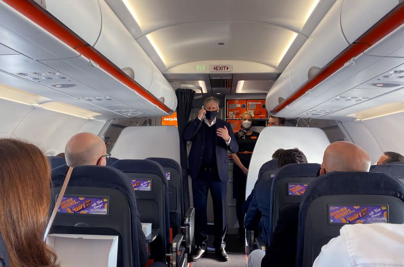 EasyJet CEO Johan Lundgren speaks to passengers during a flight to new Berlin-Brandenburg Airport (BER)
