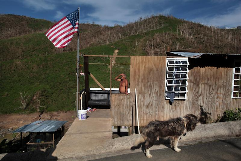 Ismael Rivera stands at his damaged house in San Lorenzo, Puerto Rico, on Oct. 4, 2017. (Alvin Baez / Reuters)