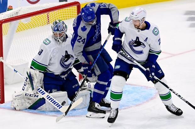 Vancouver goaltender Braden Holtby and defenceman Alex Edler are two of the seven Canucks players on the NHL COVID protocol list. (Frank Gunn/The Canadian Press - image credit)