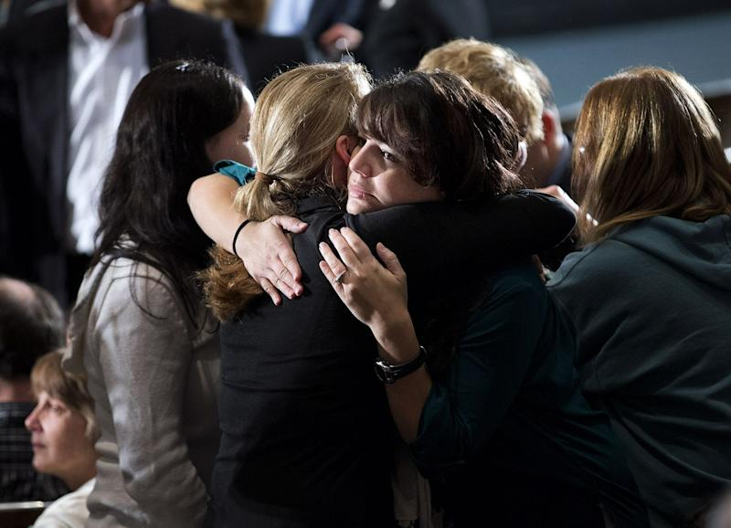 Residents greet each other before an interfaith vigil for the victims of the Sandy Hook Elementary School shooting on Sunday, Dec. 16, 2012 at Newtown High School in Newtown, Conn.