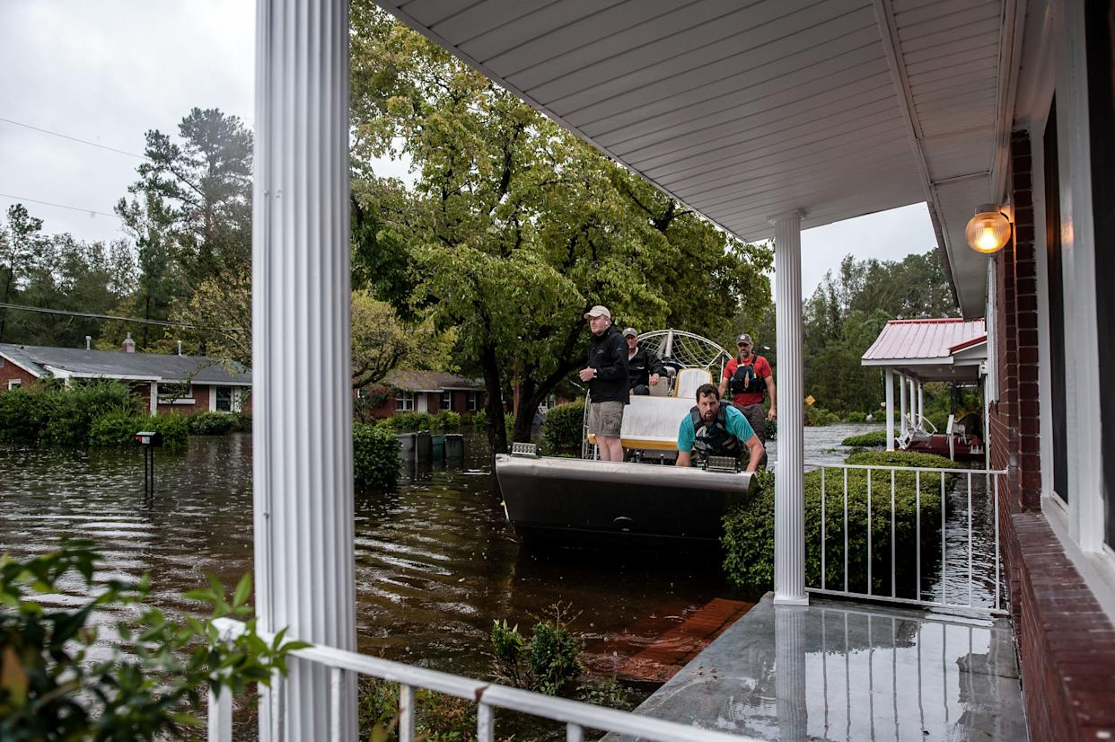 A boat crew with the Cajun Navy goes house to house to check for people in need of evacuation in Lumberton. (Photo: Joseph Rushmore for HuffPost)