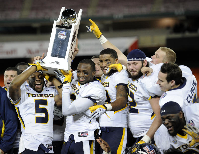 Toledo players including Diauntae Morrow (5) celebrates with the trophy after they won the Military Bowl college football game against Air Force, Wednesday, Dec. 28, 2011, in Washington. Toledo won 42-41.  (AP Photo/Nick Wass)