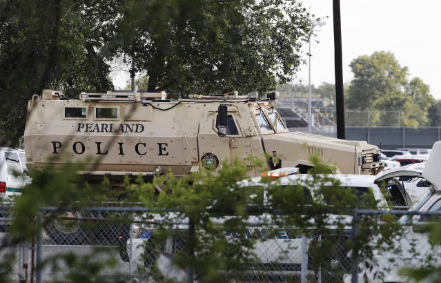 <p>A Pearland Police armored vehicle stands ready in front of Santa Fe High School in Santa Fe, Texas, in response to a shooting on Friday morning, May 18, 2018. (Photo: Kevin M. Cox/The Galveston County Daily News via AP) </p>