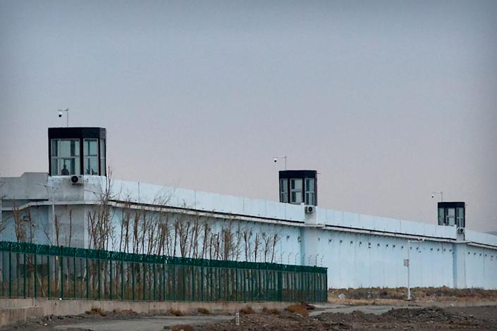 """A person stands in a tower on the perimeter of the Number 3 Detention Center in Dabancheng in western China's Xinjiang Uyghur Autonomous Region on April 23, 2021. Human rights groups and Western nations led by the United States, Britain and Germany accused China of massive crimes against the Uyghur minority and demanded unimpeded access for U.N. experts at a virtual meeting on Wednesday, May 12, 2021 denounced by China as """"politically motivated"""" and based on """"lies."""""""