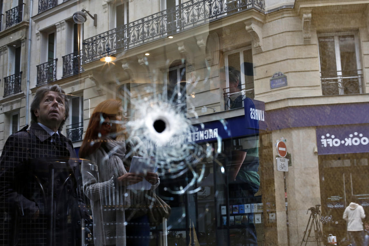 <p>A bullet hole seen on the window of a cafe located near the area where the assailant of a knife attack was shot dead by police officers, in central Paris, Sunday May 13, 2018. (Photo: Thibault Camus/AP) </p>