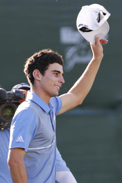 Joaquin Niemann, of Chile, celebrates a birdie putt on the last 18th hole to win the A Military Tribute at The Greenbrier golf tournament in White Sulphur Springs, W.Va., Sunday, Sept. 15, 2019. Niemann finished the tournament at 21-under-par. (AP Photo/Steve Helber)