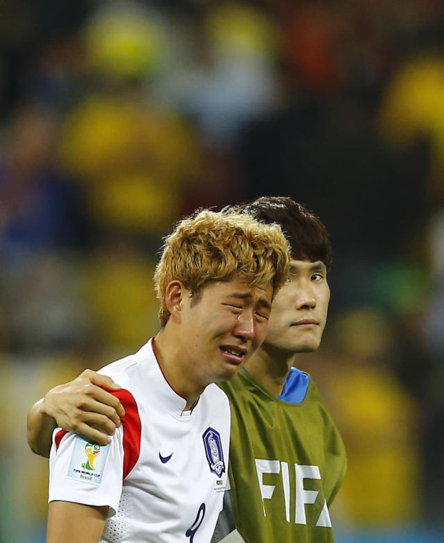 South Korea's Son Heung-min cries after the 2014 World Cup Group H soccer match between Belgium and South Korea at the Corinthians arena in Sao Paulo June 26, 2014. REUTERS/Ivan Alvarado (BRAZIL - Tags: SOCCER SPORT WORLD CUP)