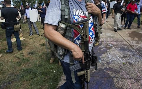 A White Supremacist open carries a rifle during clashes - Credit: Anadolu Agency/Anadolu