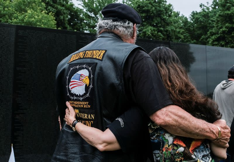 People visit the Vietnam Veterans Memorial on Memorial Day holiday in Washington
